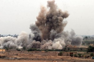 Fallujah, Iraq (Nov. 8, 2004) - An air strike is called in on a suspected insurgent hideout at the edge of Fallujah, Iraq by U.S. Marines. Image in the public domain.