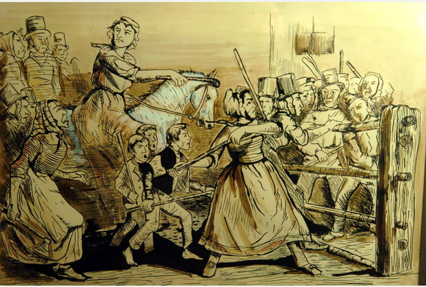 Rebecca Riots.  One of at least 10 peasant and worker uprisings in Celtic lands during the 18th and 19th century invoking sovereignty goddesses, land spirits, Fairy Witches, and other mysterious, usually female beings.  In many of these movements, men wore dresses and bonnets.