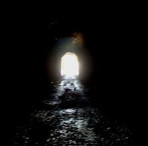 The meeting of Light and Dark (Abandoned Rail Tunnel, Donner Pass, CA) Photo by Syren