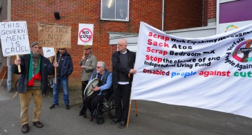 Photo: disabled people protest against cuts. By Roger Blackwell.
