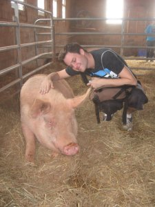 Author with a rescued pig at a sanctuary, 2009