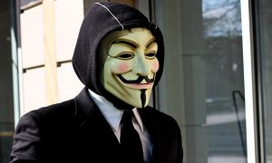 An individual wearing a suit and Guy Fawkes Anonymous mask. CC BY-SA 4.0 by Tony Webster.