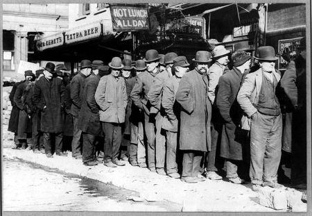 Bread line in New York City, circa 1910. [Public Domain]