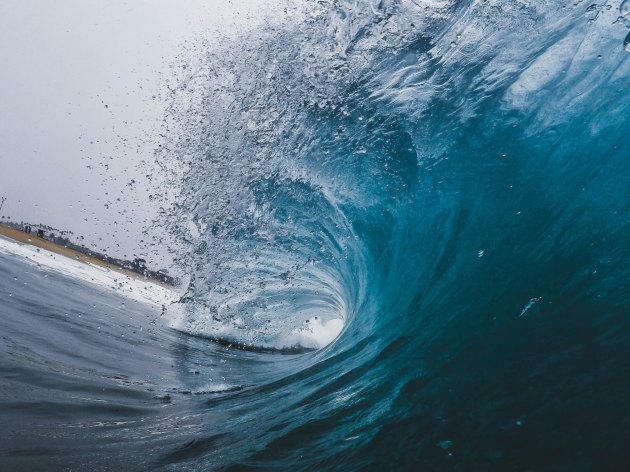 An image of a wave cresting and beginning to break.