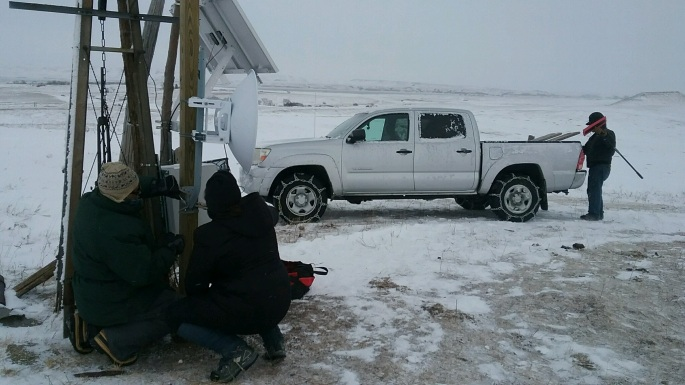 Fixing equipment on the communications tower that brought Internet into Oceti Sakowin on a freezing winter day.